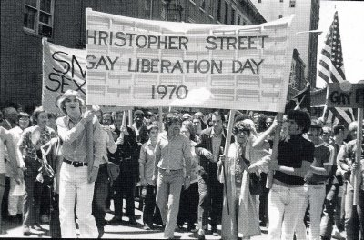 Gay, lesbian, bisexual, and transgendered individuals walk the streets on Christopher Street Day in 1970, a day celebrating their freedom of sexual expression