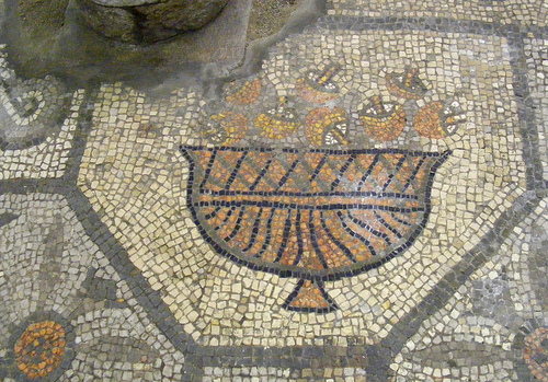 A Roman floor mosaic depicting picked edible mushrooms in a decorative bowl
