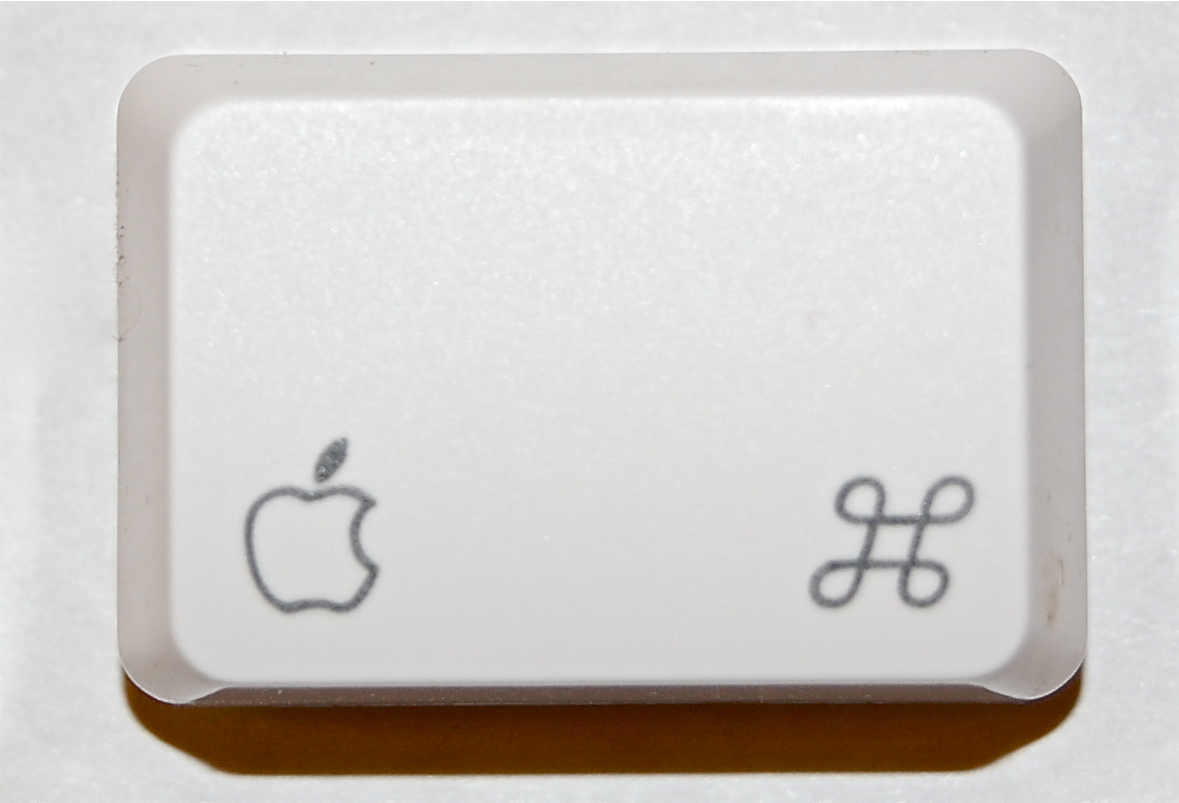 "The command key, located beside the space bar on an Apple Inc. keyboard.  Often used as the equivalent to the Window's ""ctrl"" key."