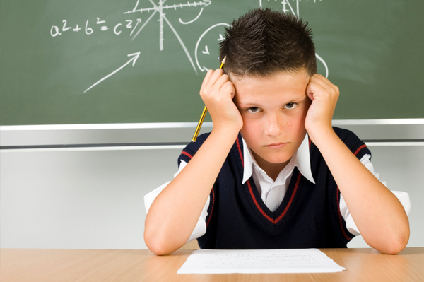 Boy taking a test, low intrinsic motivation, low thinking/creativity